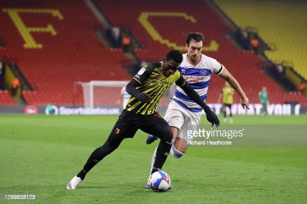 Ismaila Sarr of Watford FC controls the ball under pressure from Lee Wallace of Queens Park Rangers during the Sky Bet Championship match between...