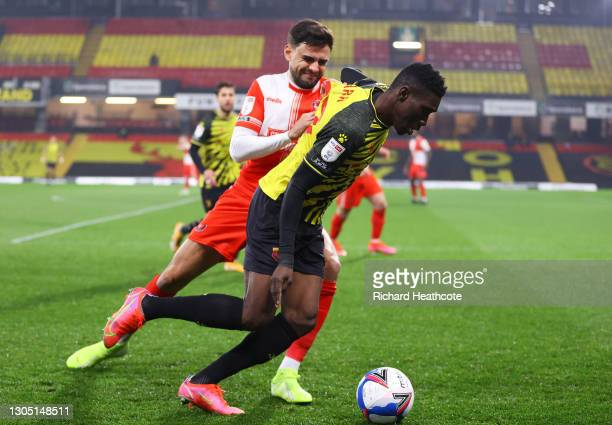 Ismaila Sarr of Watford FC is put under pressure by Ryan Tafazolli of Wycombe Wanderers during the Sky Bet Championship match between Watford and...