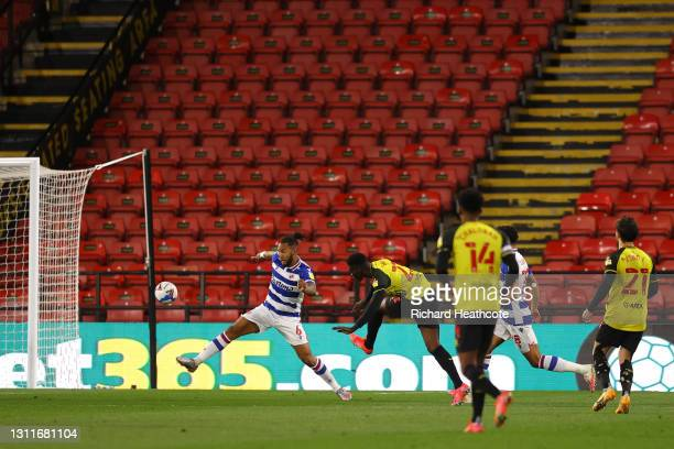 Ismaila Sarr of Watford FC scores their team's first goal past Michael Morrison of Reading FC during the Sky Bet Championship match between Watford...