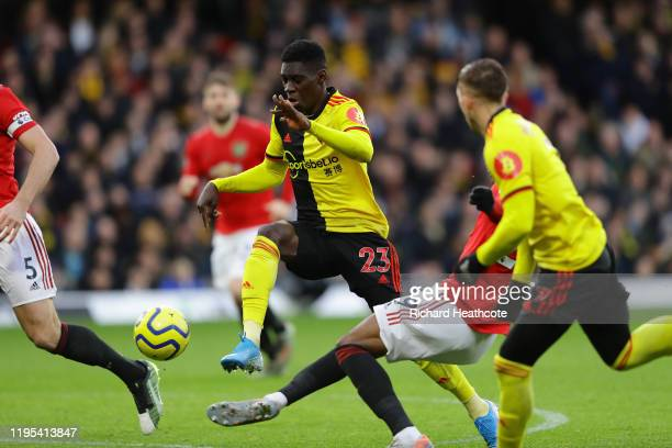 Ismaila Sarr of Watford is fouled in the area by Aaron Wan-Bissaka of Manchester United which lead to a penalty for Watford during the Premier League...