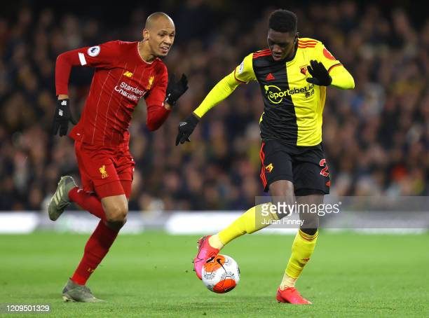 Ismaila Sarr of Watford is put under pressure by Fabinho of Liverpool during the Premier League match between Watford FC and Liverpool FC at Vicarage...