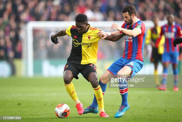 Ismaila Sarr of Watford is put under pressure by Luka Milivojevic of Crystal Palace during the Premier League match between Crystal Palace and...