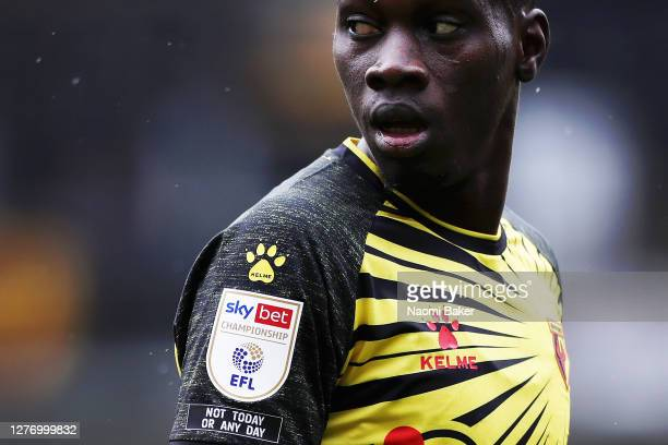 Ismaila Sarr of Watford looks on while on his sleeve reads the words 'Not today or any day' during the Sky Bet Championship match between Watford and...