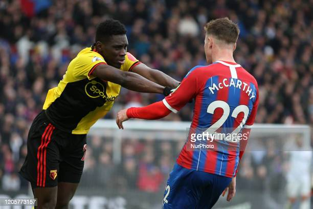 Ismaila Sarr of Watford pushing James McCarthy of Crystal Palace during the Premier League match between Crystal Palace and Watford at Selhurst Park...