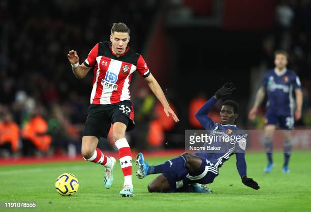 Ismaila Sarr of Watford reacts after battling with Jan Bednarek of Southampton during the Premier League match between Southampton FC and Watford FC...