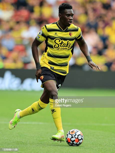 Ismaila Sarr of Watford runs with the ball during the Premier League match between Watford and Wolverhampton Wanderers at Vicarage Road on September...