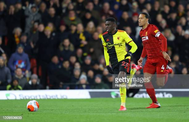 Ismaila Sarr of Watford runs with the ball past Virgil van Dijk of Liverpool to score his team's second goal during the Premier League match between...