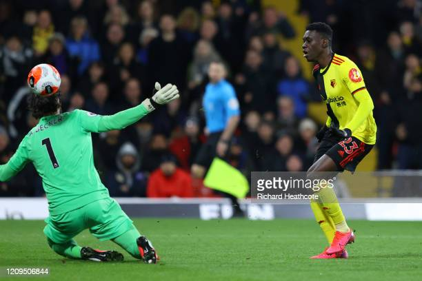 Ismaila Sarr of Watford scores his team's second goal past Alisson Becker of Liverpool during the Premier League match between Watford FC and...
