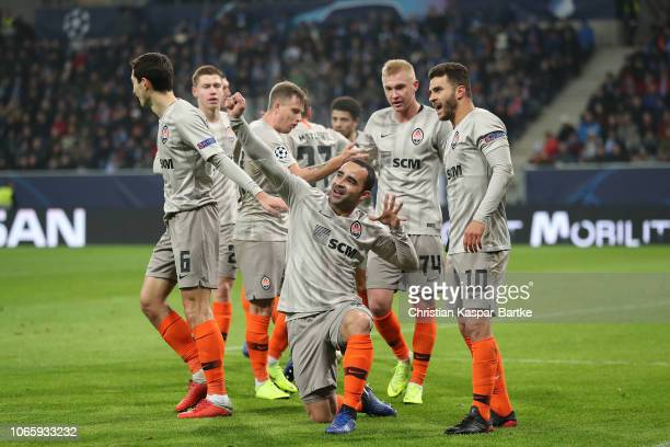 Ismaily of FC Shakhtar Donetsk celebrates with teammates his team`s first goal during the Group F match of the UEFA Champions League between TSG 1899...