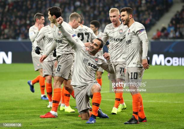 Ismaily of Shakhtar Donetsk celebrates after scoring his team's first goal with team mates during the Group F match of the UEFA Champions League...