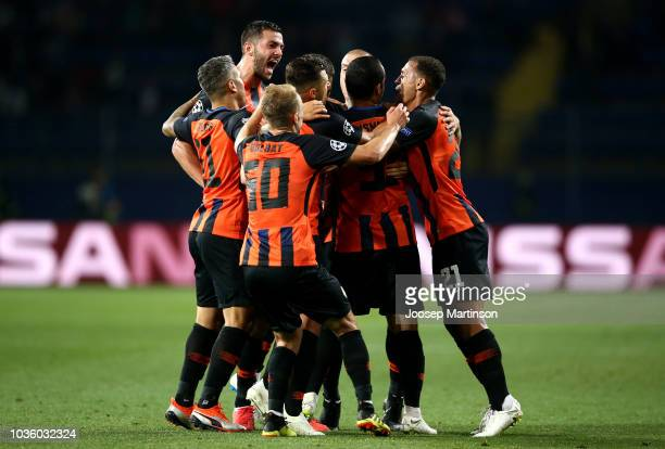 Ismaily of Shakhtar Donetsk celebrates with teammates after scoring his team's first goal during the Group F match of the UEFA Champions League...