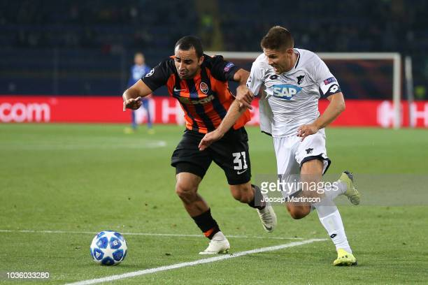 Ismaily of Shakhtar Donetsk is challenged by Steven Zuber of 1899 Hoffenheim during the Group F match of the UEFA Champions League between FC...