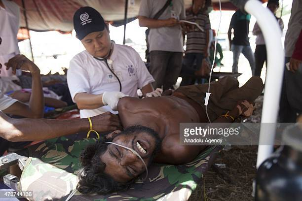 Isman a Bangladeshi migrant receives medical care in a temporary medical clinic installed in the Kuala Langsa Port in Langsa Aceh province Indonesia...