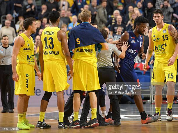 Ismet Akpinar Malcolm Miller Niels Giffey of Alba Berlin Quincy Diggs of the Eisbaeren Bremerhaven and Bogdan Radosavljevic of Alba Berlin during the...
