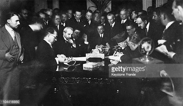 Ismet PACHA Turkish Minister of Foreign Affairs since 1921 and Greek Prime Minister Eleftherios VENIZELOS signing the clause of the Treaty of...