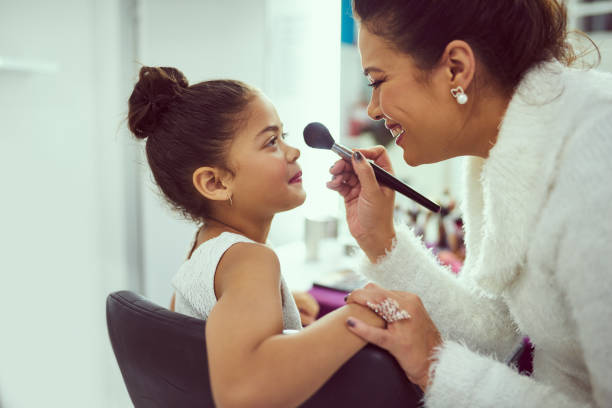isn't that enough blusher already, mom? - stage mother stock pictures, royalty-free photos & images