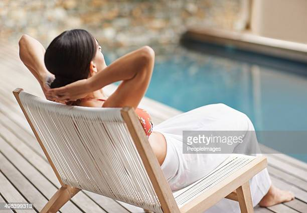 isn't this the life... - sun lounger stock pictures, royalty-free photos & images