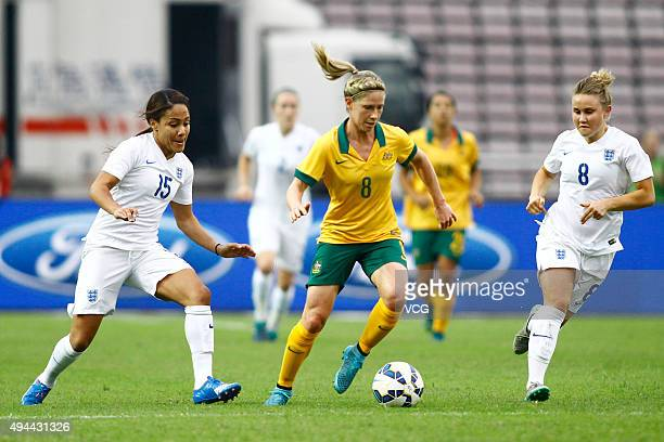 Isobel Christiansen and Alex Scott of England and Elise KellondKnight of Australia compete for the ball in the match between England and Australia...