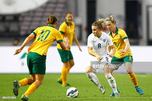 Isobel Christiansen of England and Emily van Egmond and Elise KellondKnight of Australia compete for the ball in the match between England and...