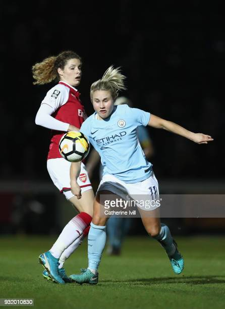 Isobel Christiansen of Manchester City is challenged by Dominique Janssen of Arsenal during the WSL Continental Cup Final between Arsenal Women and...