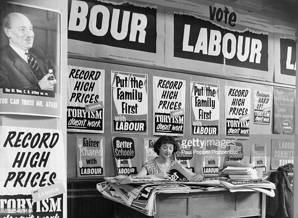 Isobel Hurll a staff member at Transport House the London headquarters of the Labour Party sorts through election posters under the watchful eye of...