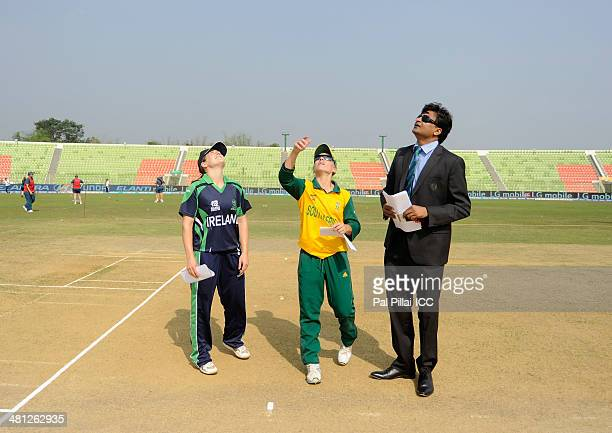 Isobel Joyce captain of Ireland Mignon Du Preez captain of South Africa and ICC match referee Javagal Srinath during the toss before the start of the...