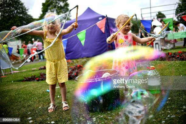 Isobella Blackburn 3 and Isla Lynn 2 make bubbles as people attend a Great Get Together event in memory of murdered MP Jo Cox on June 17 2017 in...