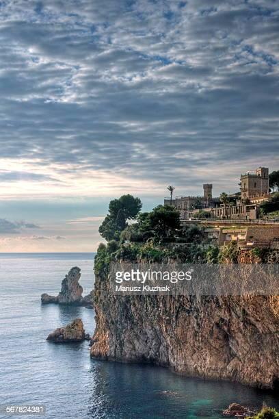 isola bella bay sunrise on rocky cliff - sizilien stock-fotos und bilder