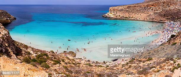 isola dei conigli (rabbits island) and beach - lampedusa stock pictures, royalty-free photos & images