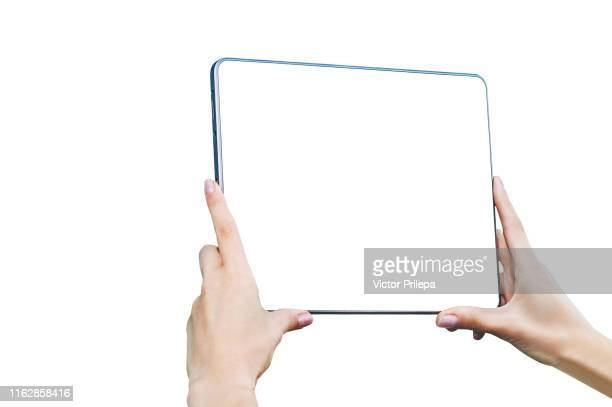 isolate mock up tablet in female hands - closeup, on a white background. - pc ultramobile foto e immagini stock