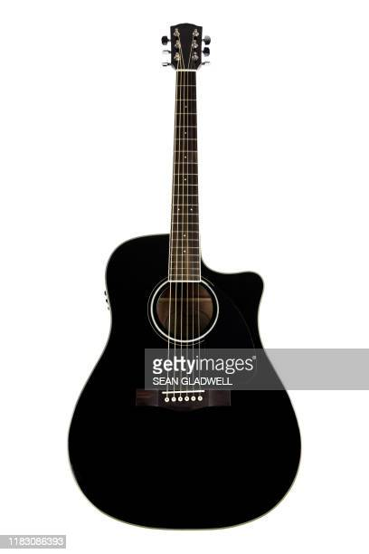 isolated acoustic guitar - acoustic guitar stock pictures, royalty-free photos & images