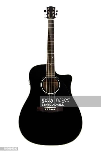 isolated acoustic guitar - guitarrista fotografías e imágenes de stock