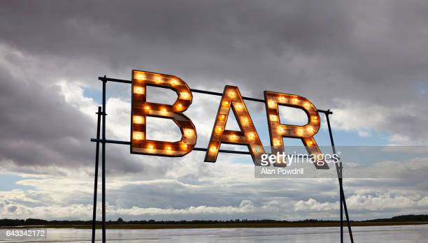 Isolated Bar Sign on Scaffold Against Sky