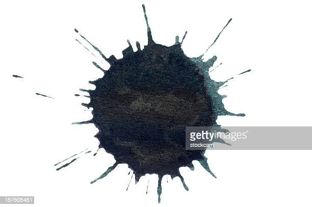 Isolated black ink splatter drop close-up