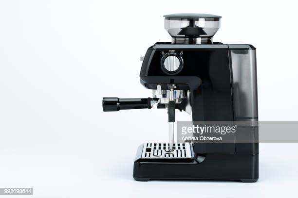 Isolated black manual coffee maker with grinder on a white background, side view