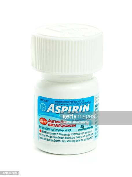 isolated bottle of daily low dose bayer aspirin - aspirin stock pictures, royalty-free photos & images