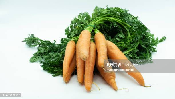 isolated bunch of carrots isolated on white background - bunch stock pictures, royalty-free photos & images