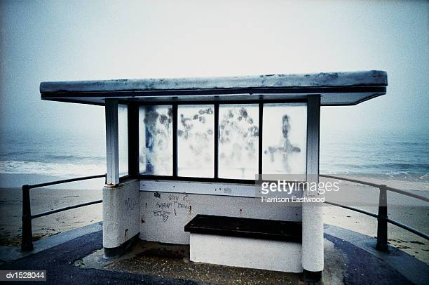 isolated bus shelter on bournemouth beach, united kingdom - run down stock pictures, royalty-free photos & images