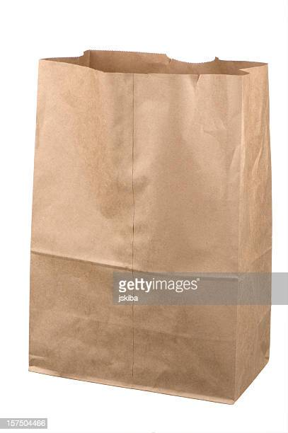 Isolated empty brown grocery bag on white background