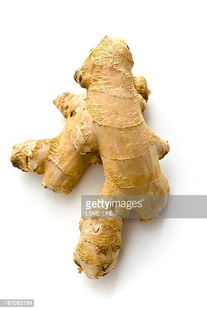 isolated fresh ginger root on white background - ginger stock photos and pictures
