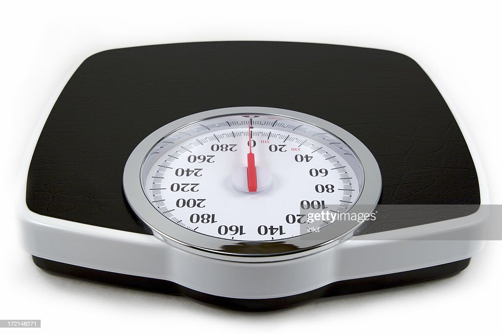 Isolated Image Of A Black And White Analog Bathroom Scale : Stock Photo