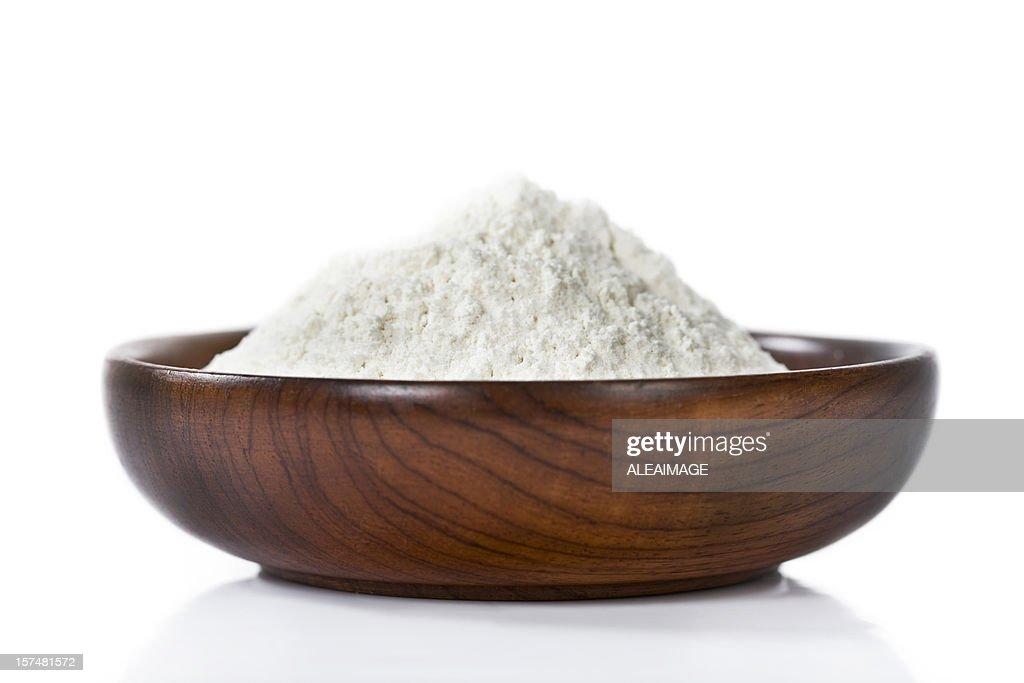 Isolated image of flour in a wooden bowl : Stock Photo