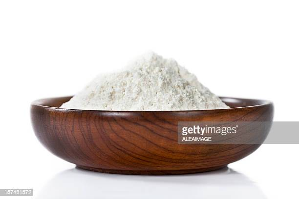 Isolated image of flour in a wooden bowl
