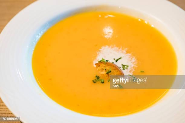 Isolated photograph of pumpkin soup in a white bowl