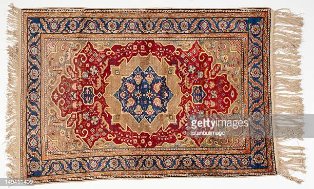 isolated picture of a traditional middle-eastern rug - tapijt stockfoto's en -beelden