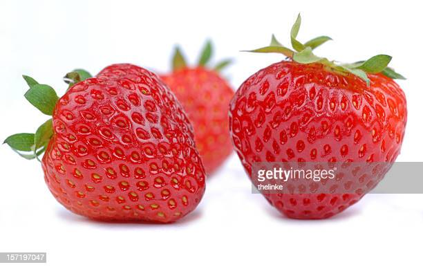 Isolated picture of three fresh strawberries