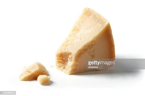 isolated piece of parmesan - parmesan cheese stock pictures, royalty-free photos & images