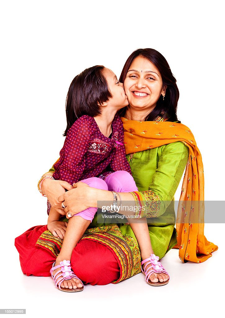 Isolated Portrait of Affectionate Cheerful Indian Mother and Daughter Kissing : Stock Photo
