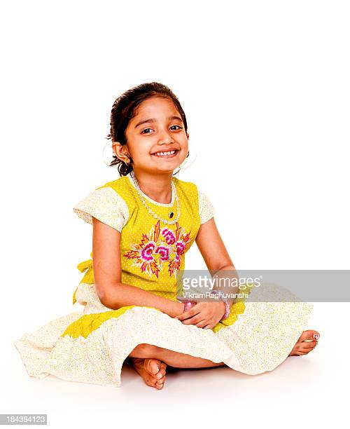 Isolated Portrait of Indian Little Girl Sitting on White Background
