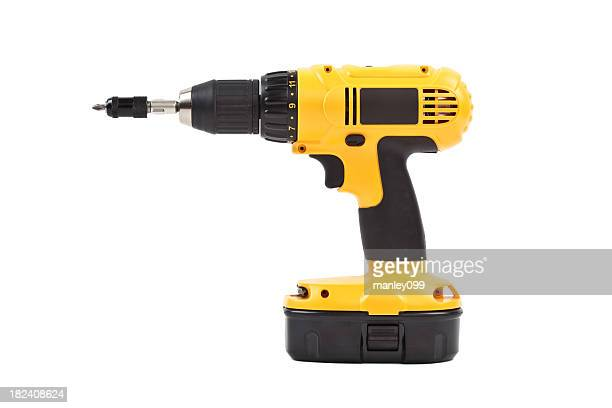 isolated power tool in yellow - drill stock pictures, royalty-free photos & images